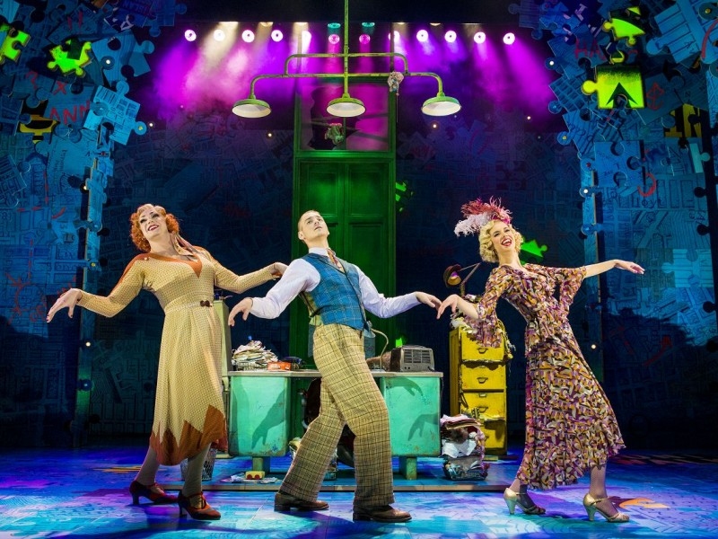 l-r Craig Revel Horwood (Miss Hannigan), Jonny Fines (Rooster), Djalenga Scott (Lily)  in 'Annie' (London)  © Matt Crockett