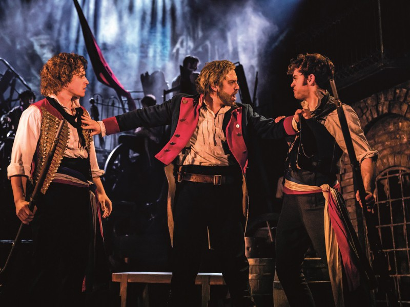 Ashley Gilmour (Enjolras), Jon Robyns (Jean Valjean), Harry Apps (Marius)  in 'Les Misérables' (London)  © Johan Persson